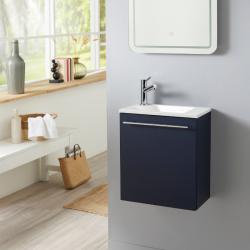 Meuble lave-mains pour WC bleu nuit avec vasque design blanche et mitigeur inclus.